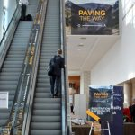 Photo of vinyl banner placed indoors beside an escalator.
